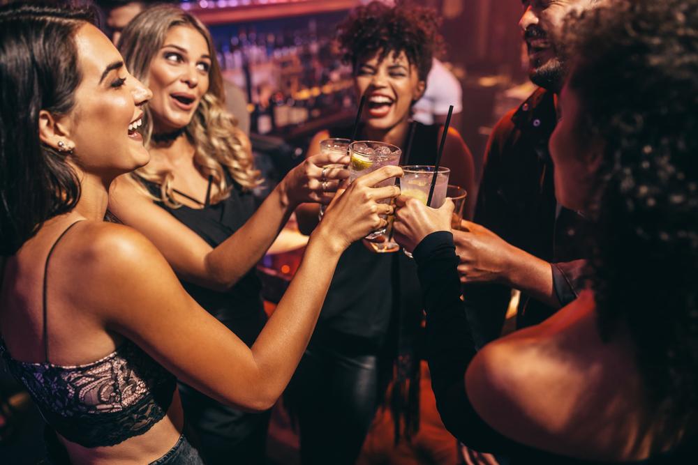 Group of friends drinking in nightclub