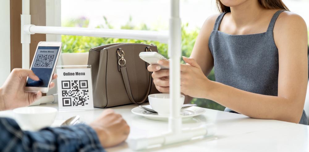 Couple using QR codes