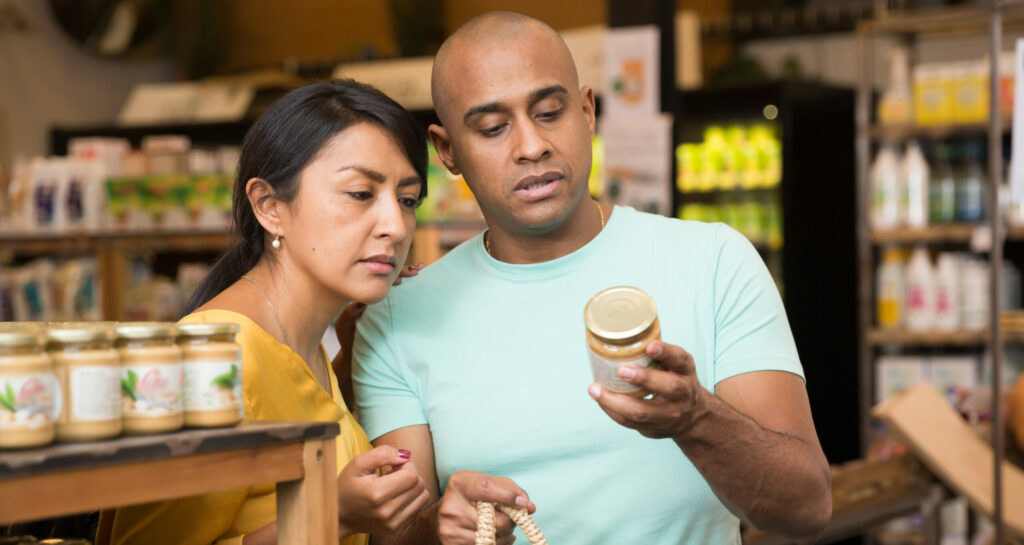 Couple checking food label